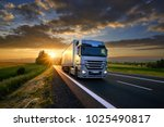truck driving on the asphalt... | Shutterstock . vector #1025490817