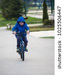 little boy riding a bicycle a... | Shutterstock . vector #1025506447