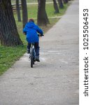 little boy riding a bicycle a... | Shutterstock . vector #1025506453