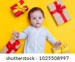 little baby with holiday gifts... | Shutterstock . vector #1025508997
