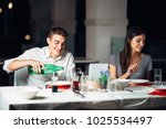 smiling woman on a date in a... | Shutterstock . vector #1025534497