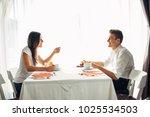 happy couple at restaurant... | Shutterstock . vector #1025534503