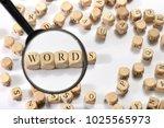 words word on wooden cubes.... | Shutterstock . vector #1025565973