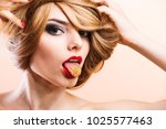 young blonde girl model with a... | Shutterstock . vector #1025577463