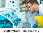 Small photo of Two young male scientist working at the modern laboratory checking lab machines during research process copyspace technology researching chemistry microbiology occupation career clinical survey job.