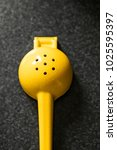 a bright yellow citrus squeezer ... | Shutterstock . vector #1025595397