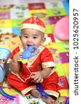 8 month old baby wearing a red... | Shutterstock . vector #1025620957
