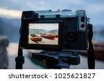 modern milc camera on a tripod...   Shutterstock . vector #1025621827