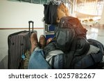 man who has a lot of bags  sits ... | Shutterstock . vector #1025782267