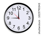 round clock face showing nine o'... | Shutterstock .eps vector #1025790343