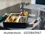 bento box in japanese restaurant | Shutterstock . vector #1025865967