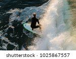 overhead view of surfer on wave ... | Shutterstock . vector #1025867557