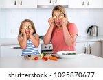 attractive woman cooking... | Shutterstock . vector #1025870677