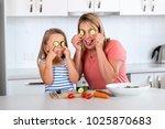 attractive woman cooking... | Shutterstock . vector #1025870683