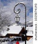 Snow On Streetlight In Small...
