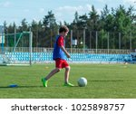 boy practices dribbling on the... | Shutterstock . vector #1025898757