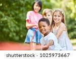 african boy and his friends as... | Shutterstock . vector #1025973667