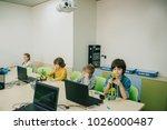 group of focused kids working... | Shutterstock . vector #1026000487