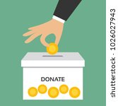 man's hand donating money... | Shutterstock .eps vector #1026027943