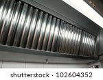 Exhaust systems, hood filters detail in a professional kitchen - stock photo