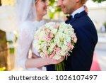 bride and groom posing in park | Shutterstock . vector #1026107497