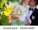 wedding shot of bride and groom ... | Shutterstock . vector #1026116587