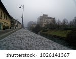 old arch stone bridge in foggy... | Shutterstock . vector #1026141367