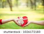 a present given from hand to... | Shutterstock . vector #1026172183