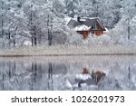snowy reflections . lake bijote ... | Shutterstock . vector #1026201973