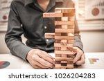 hands of business man playing a ... | Shutterstock . vector #1026204283