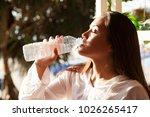 woman drinking water | Shutterstock . vector #1026265417