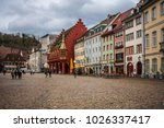 Small photo of Freiburg, Germany - January 2018: Beautiful colorful residential houses and the building of the old historical burse on the market square in Freiburg in South Germany