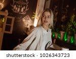 beautiful girl sitting in... | Shutterstock . vector #1026343723