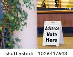 voting sign at a polling station | Shutterstock . vector #1026417643