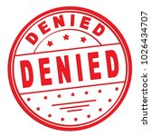 "rubber stamp with text ""denied"" ... 