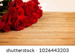 Stock photo beautiful red valentines roses on a wooden table 1026443203