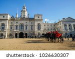 Small photo of London / UK - November 17 2017: red cavalryman troop on strong black horse at The Household Cavalry Museum