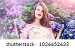 woman in flowers. woman with... | Shutterstock . vector #1026652633