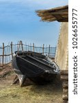 Rural Scene With Wooden Boat...