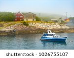 boat near coast with homes in...   Shutterstock . vector #1026755107