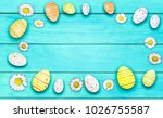 daisies and easter eggs on... | Shutterstock . vector #1026755587