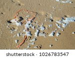 orange nylon cable on a sandy... | Shutterstock . vector #1026783547