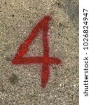 Small photo of Abstract number 4, red paint style on concrete floor