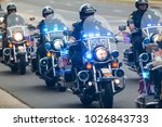 Small photo of Buford, GA, USA - October 7, 2017: Several motorcycle cops provide an escort to a group of motorcyclists about to start a charity bike ride on October 7, 2017 in Buford, GA.
