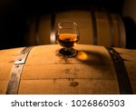 a glass of whiskey sits atop of ... | Shutterstock . vector #1026860503