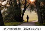 Stock photo man and dog young man with his dog in nature in autumn silhouette of man and dog walking on 1026921487