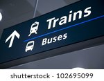 train and bus directional signs in airport - stock photo
