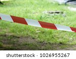 red and white lines of barrier... | Shutterstock . vector #1026955267