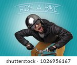 kooky young guy on a bike with... | Shutterstock . vector #1026956167