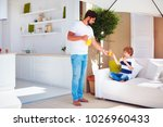 father treats son with fresh... | Shutterstock . vector #1026960433